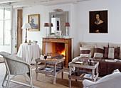Lit open fire in rustic living room