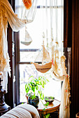 Artistically draped curtains and small sailing boats