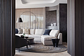 Elegant living room with upholstered furniture and dark wall