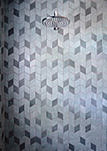 Rain shower in the bathroom with 3D tile pattern