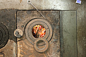 Top view of wood-fired cooker with view of fire through hob