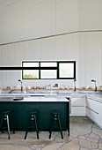 Modern country-house kitchen without wall units in architect-designed house