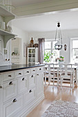 View from kitchen into dining room in Scandinavian country-house style