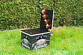 DIY beer-crate chair decorated with garland in German colours
