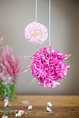 Flower balls made from chrysanthemums and heather