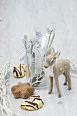 Cutlery and handmade name tags in jar, Christmas biscuits and deer figurine