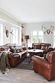 Brown leather sofa set in classic living room