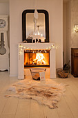 Fire in open fireplace with festive decorations