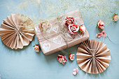 Paper rosettes, gift box and roses