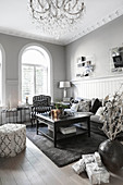 Elegant living room in shades of grey with arched windows