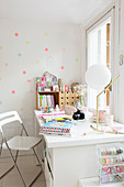 Polka-dots on wall behind desk below window