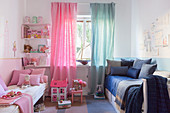 Two-tone children's bedroom half in pink and half in blue