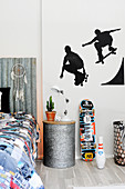 Silhouettes of skateboarders on wall of teenager's bedroom