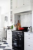 Gas cooker in black and white country-house kitchen