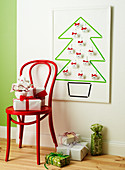 Chair with gifts in front of Christmas tree-shaped advent calendar