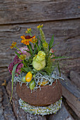 Autumnal flower arrangement in sapucaia nut shell