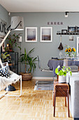 Eclectic mixture of styles in living-dining room in shades of grey