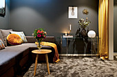 Dark living room in shades of grey and ochre
