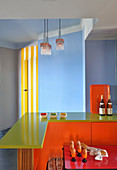 Colourful breakfast bar in kitchen with blue walls