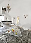 Delicate designer furniture in white living room