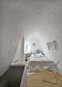 White bedroom with vaulted ceiling