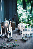 Slim white candles in candle clips on wire circlet