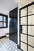 Patterned tiled floor in classic black-and-white bathroom