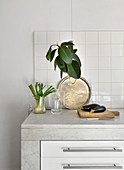 Simple decorative arrangement on marble kitchen worksurface