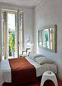 Simple bedroom in Mediterranean period building