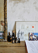 Artistic still-life arrangement of pictures and old bottles