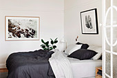 Double bed with black and white bed linen