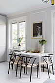 White dining table and chairs in bright kitchen
