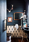 Glance into the bathroom with dark blue wooden paneling in the former church