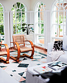 Designer chairs in the winter garden with arched windows