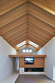 Open roof structure in modern architect-designed house with mezzanine