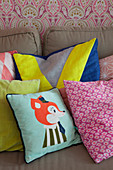 Various scatter cushions on sofa