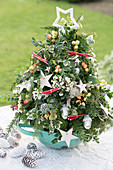 Festive arrangement in shape of Christmas tree in colander