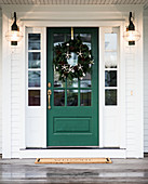 Front door decorated with Christmas wreath