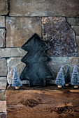Pewter Christmas tree on wooden beam