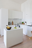 Island counter in white kitchen