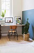 Simple desk and chair below window in bedroom