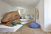 Bed on masonry platform next to boulders