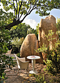 Seating area surrounded by granite boulders in garden