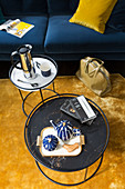 Two round coffee tables with metal frames on yellow rug
