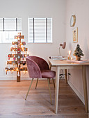 Desk, shell chair and DIY Christmas tree made from reclaimed wooden boards