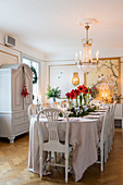 Festively set table in dining room in antique Swedish style