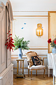 Antique furniture in festive dining room with panelled walls