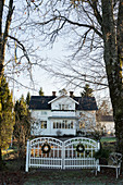 Festively decorated front gate of Swedish house