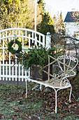 Festively decorated bench next to front gate