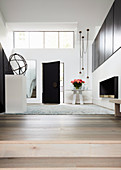 Elegant, minimalist entrance hall with gallery